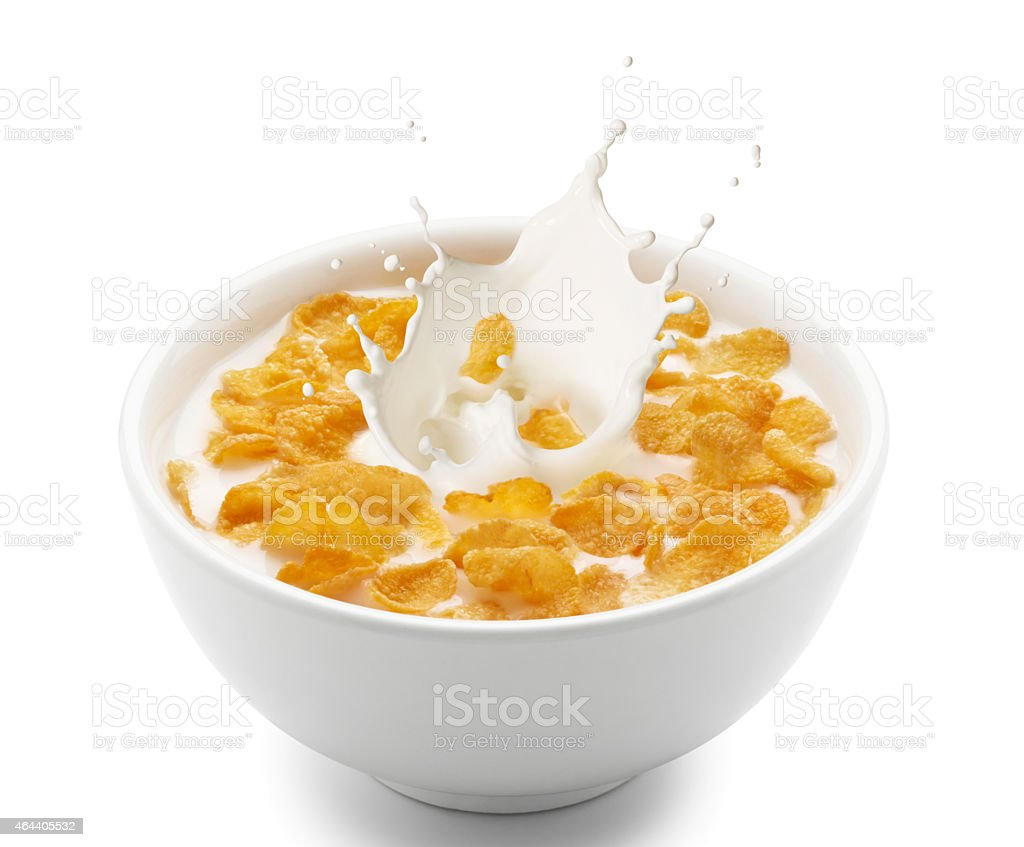 corn flakes with milk splash stock photo
