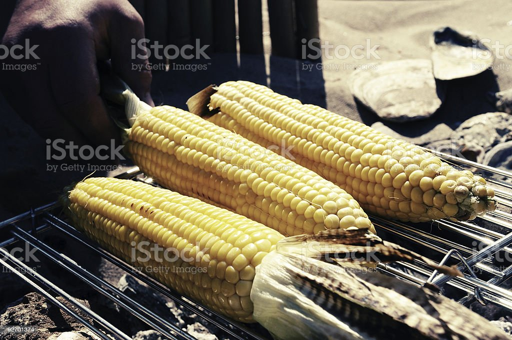 Corn grilling on a beach barbeque royalty-free stock photo