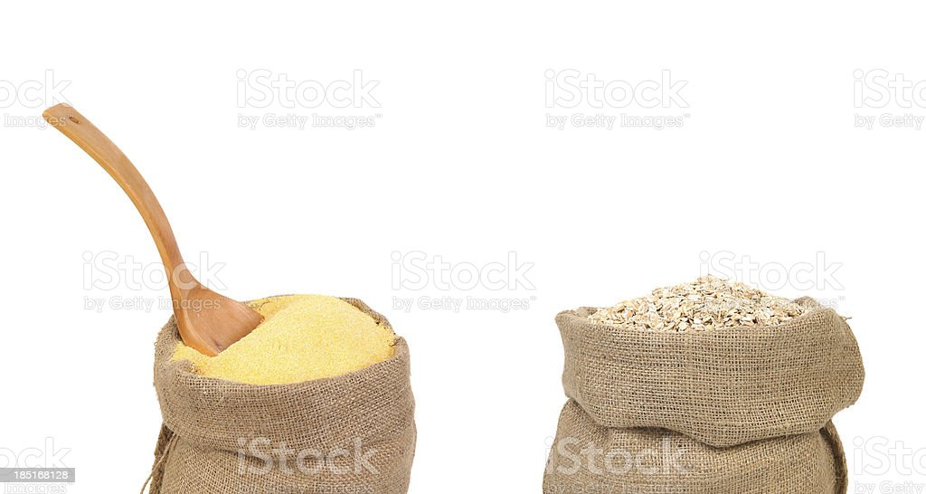 Corn meal and oatmeal flakes in bag. stock photo