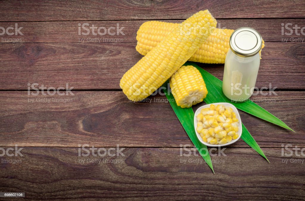 Corn on a wooden table. stock photo