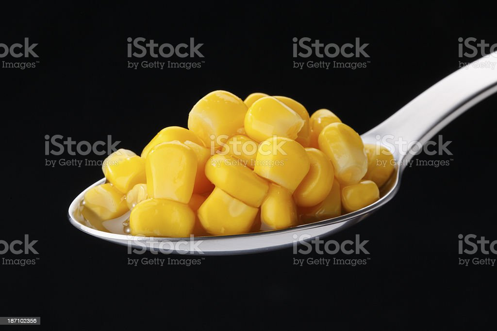 Corn on spoon royalty-free stock photo
