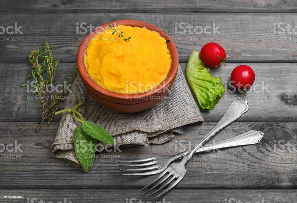 Corn porridge Polenta in ceramic bowl stock photo
