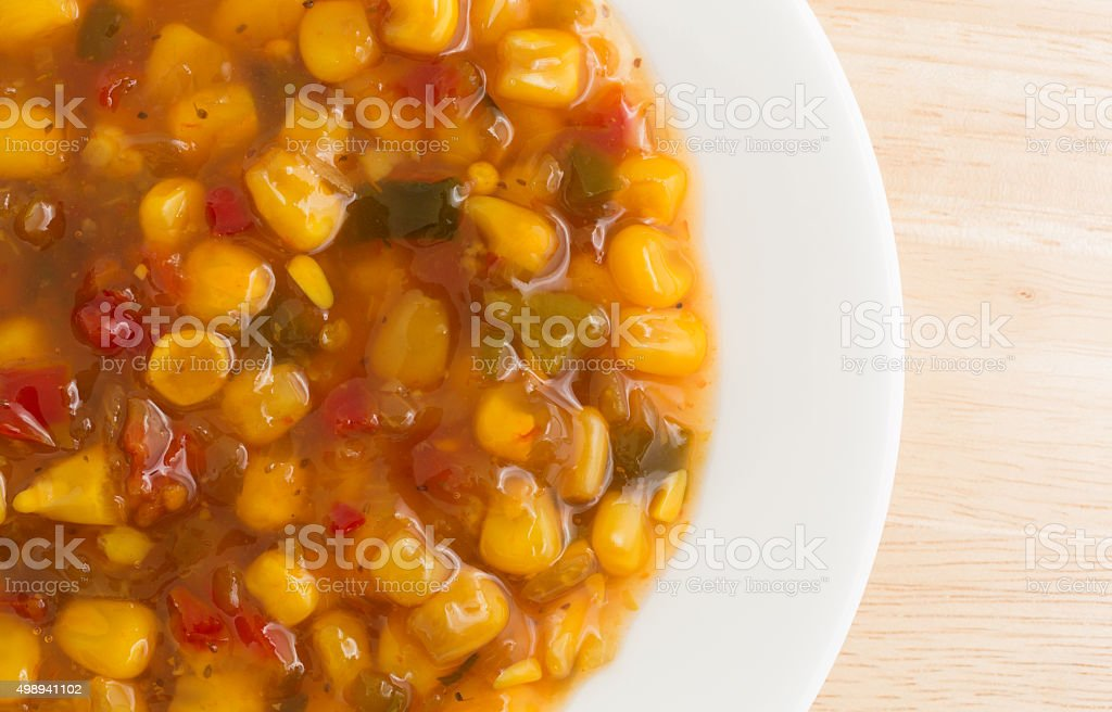 Corn relish in a white dish top view stock photo