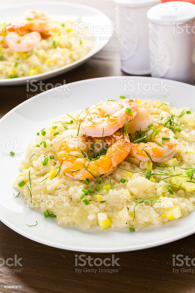 Corn Risotto with Roasted Shrimp stock photo