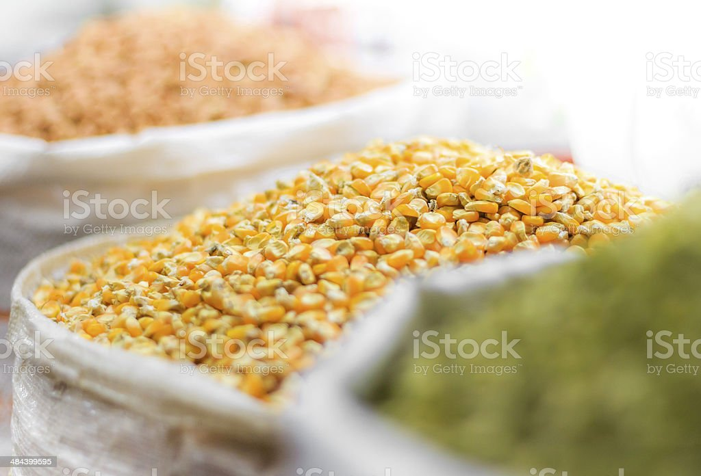 Corn seeds and other grains in bags on oriental market stock photo