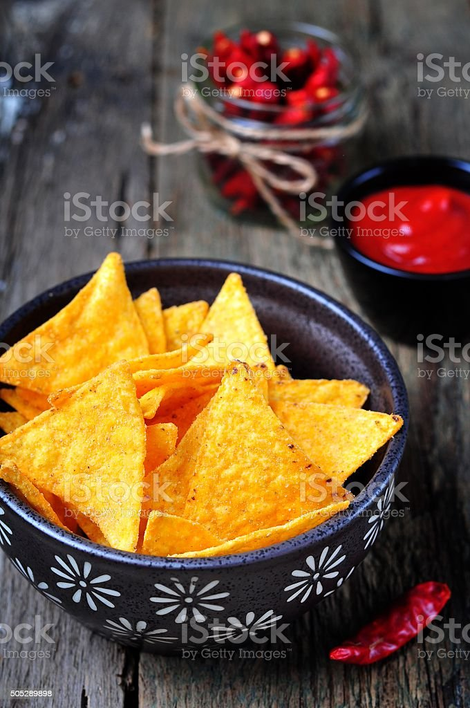 Corn Tortilla Chips or Nachos with tomato sauce stock photo