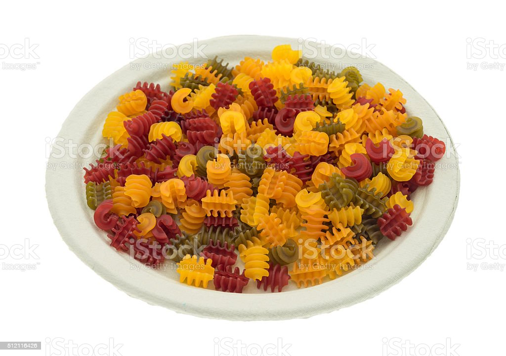 Corn vegetable radiatore pasta on a paper plate stock photo