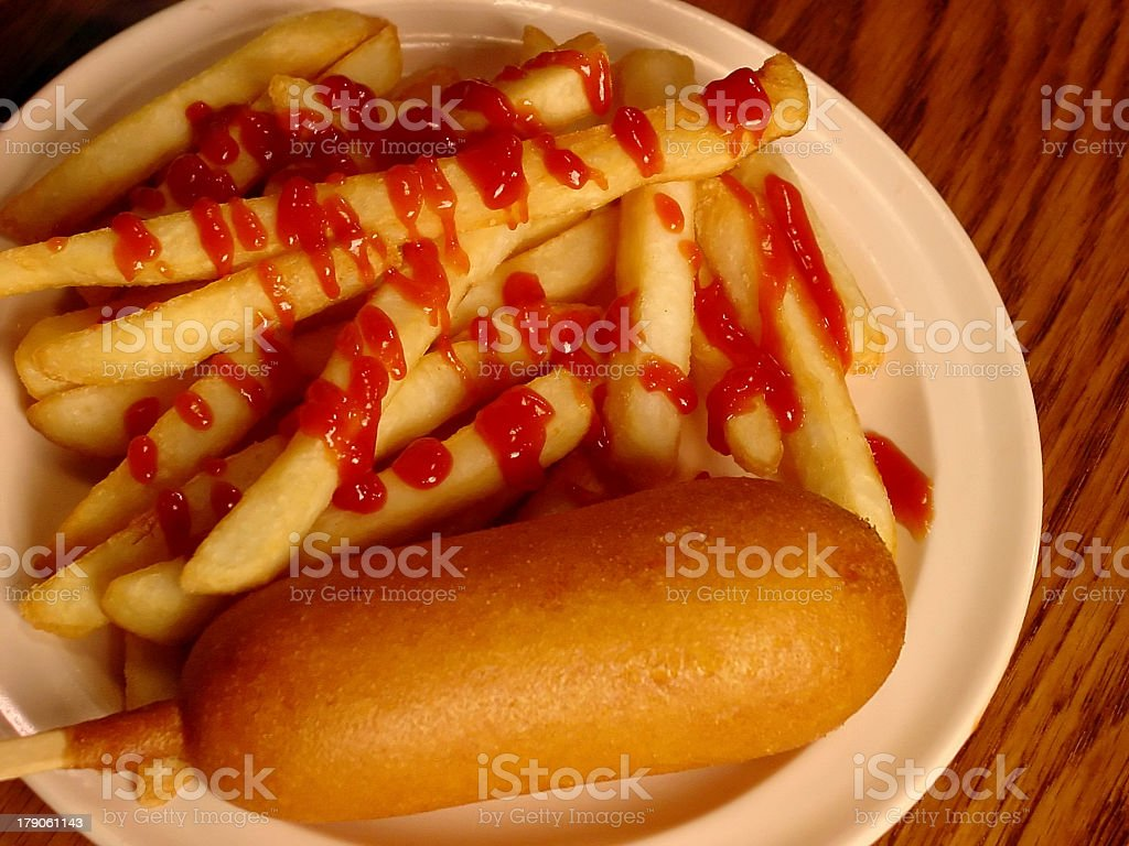 Corndog with french fries and ketchup royalty-free stock photo