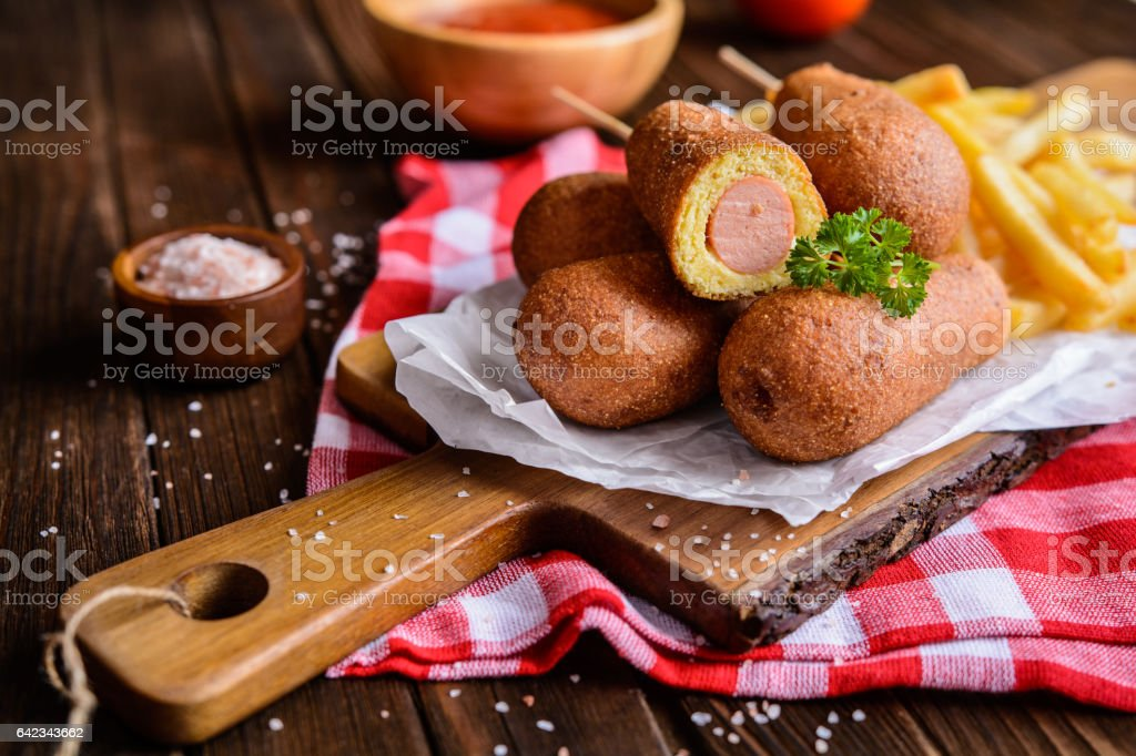 Corndogs with fries, ketchup and mustard stock photo