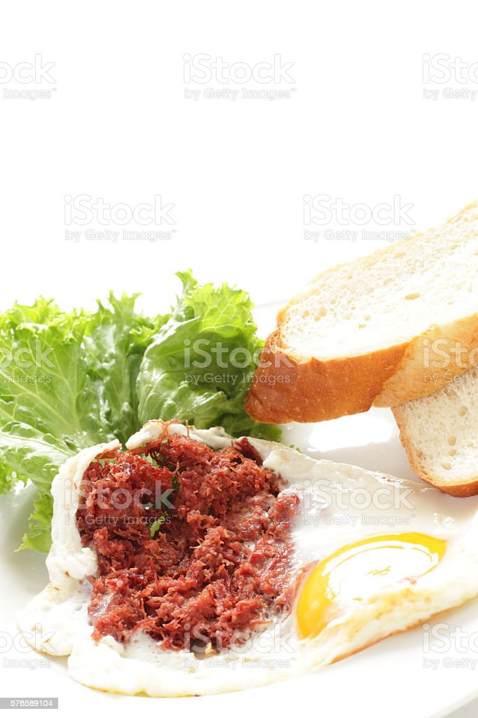 corned beef and sunny side up fried egg stock photo