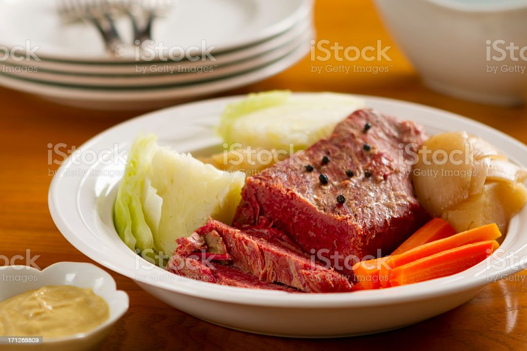 Corned beef dinner with cabbage, onion and carrots stock photo
