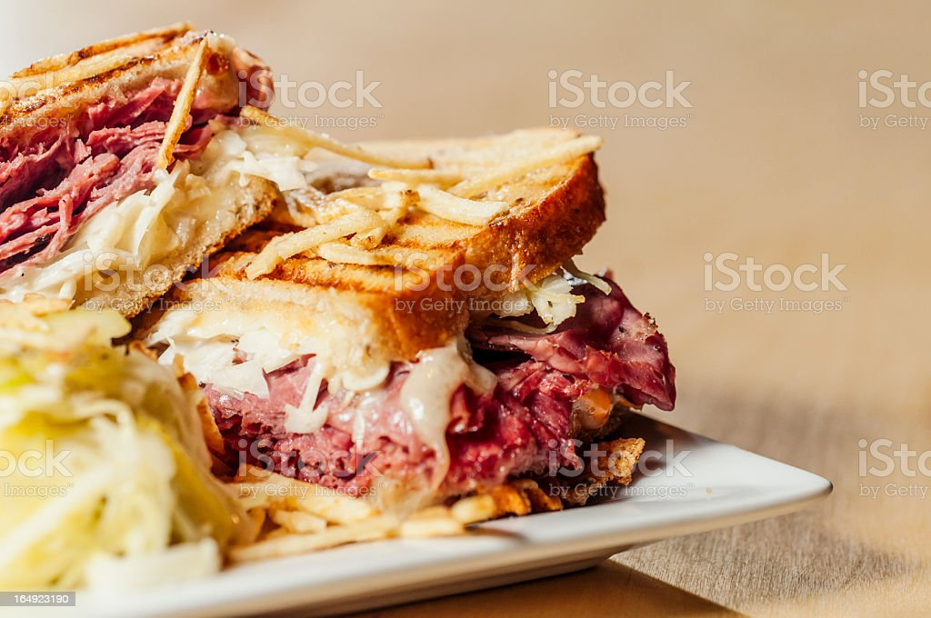 A corned beef sandwich on a plate stock photo