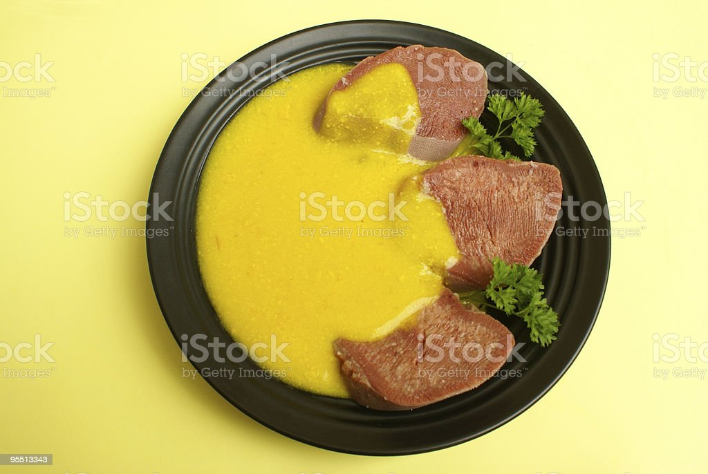 Corned beef tongue with mustard sauce royalty-free stock photo