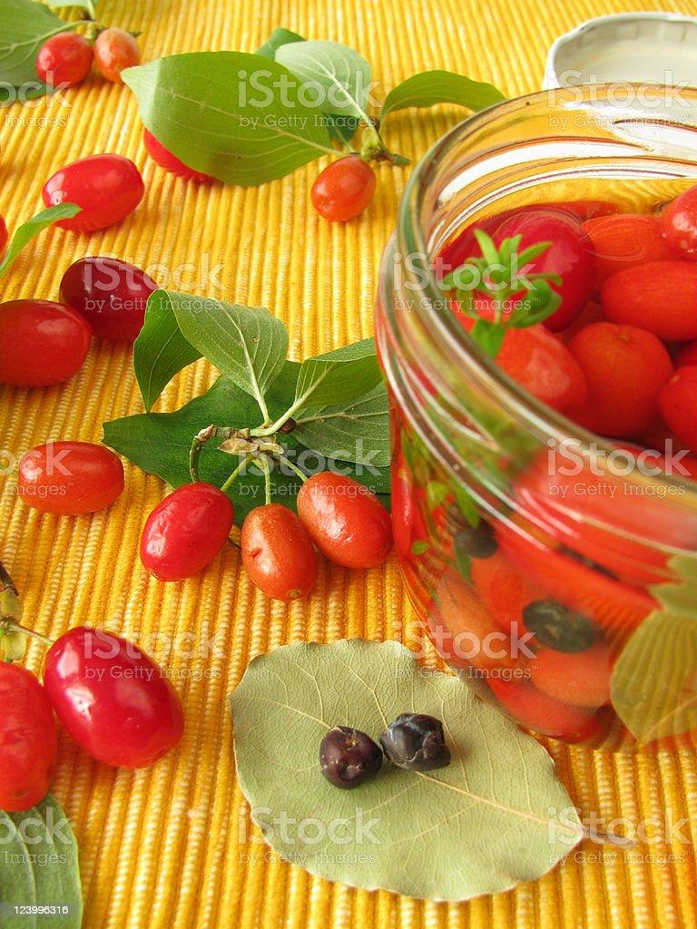 Cornelian cherries in vinegar marinade royalty-free stock photo