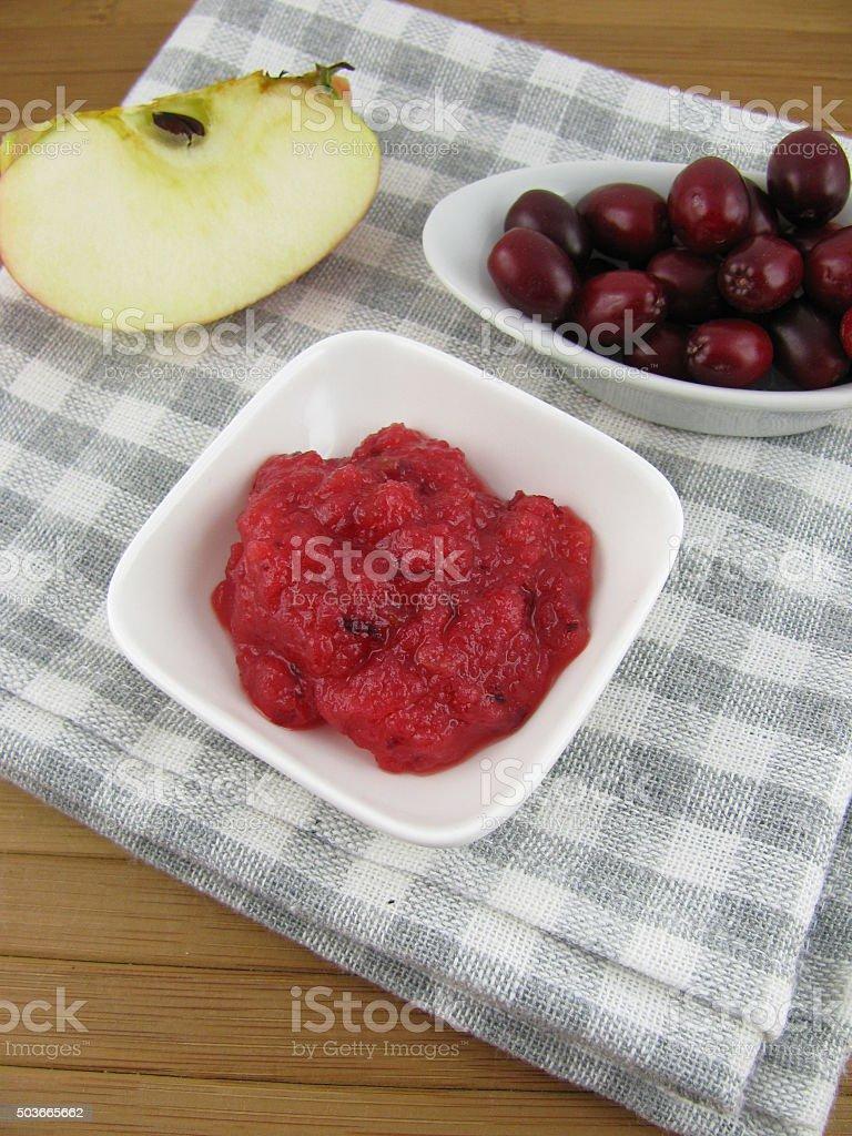 Cornelian cherry jam in a small bowl stock photo