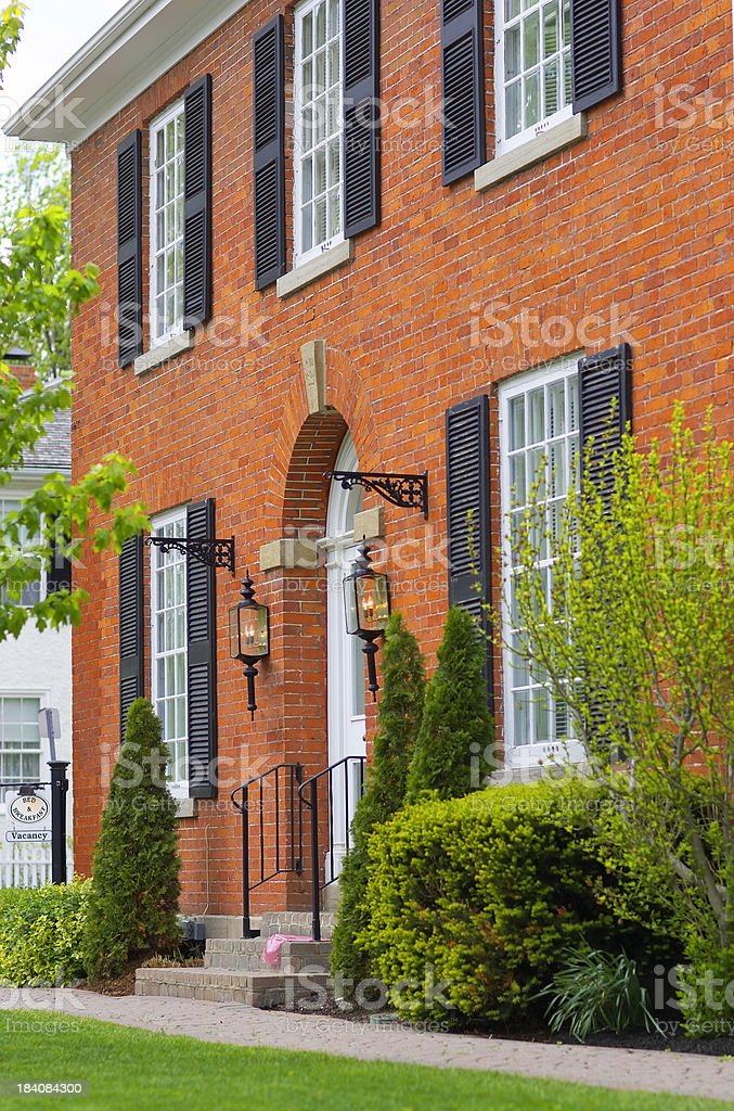 Corner brick house stock photo