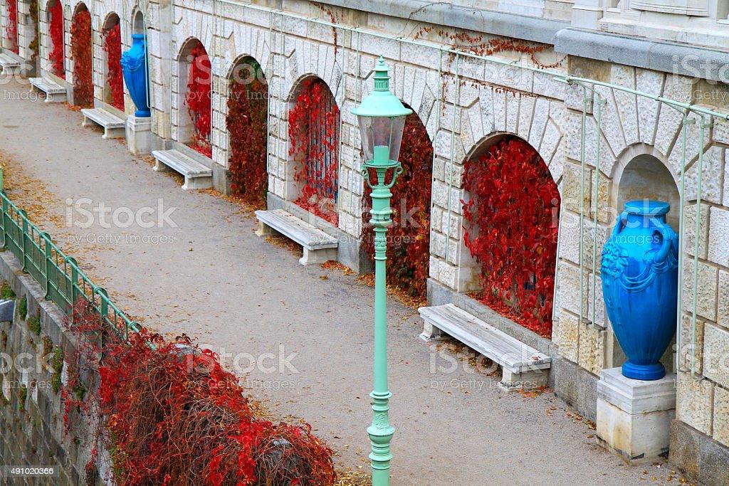 Corner footpath in StadtPark, Vienna, autumn romance rest bench, Austria stock photo