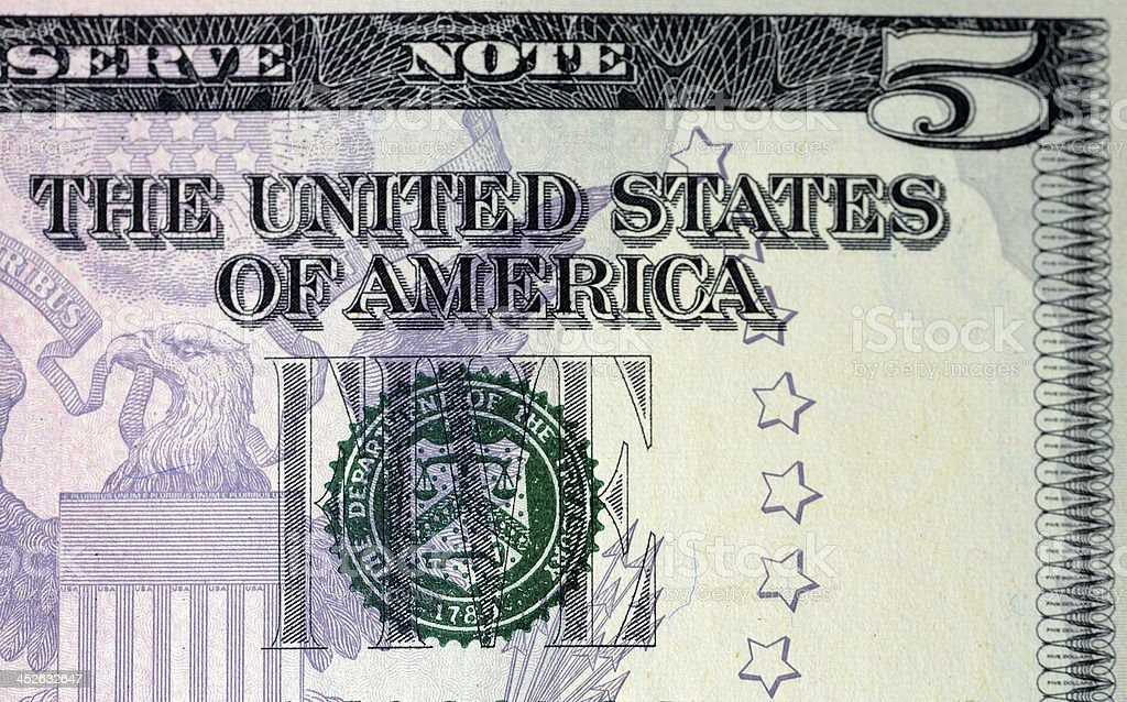 Corner of a five dollar bill stock photo