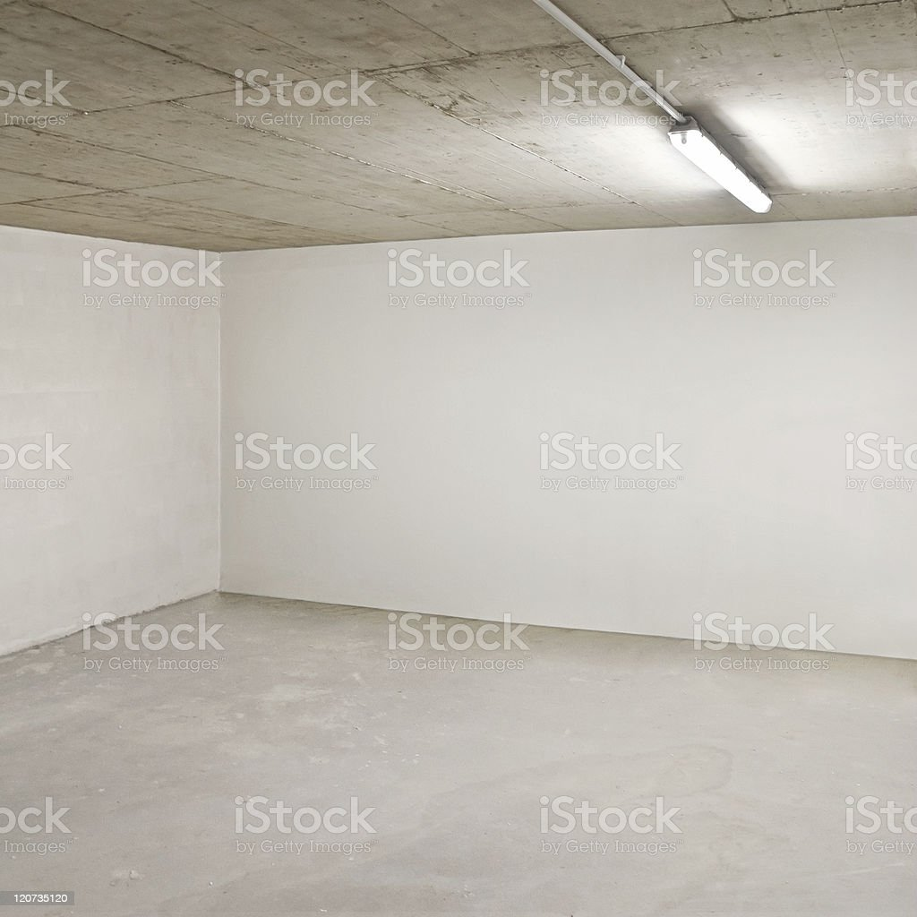 Corner of an empty beige room with fluorescent lighting royalty-free stock photo