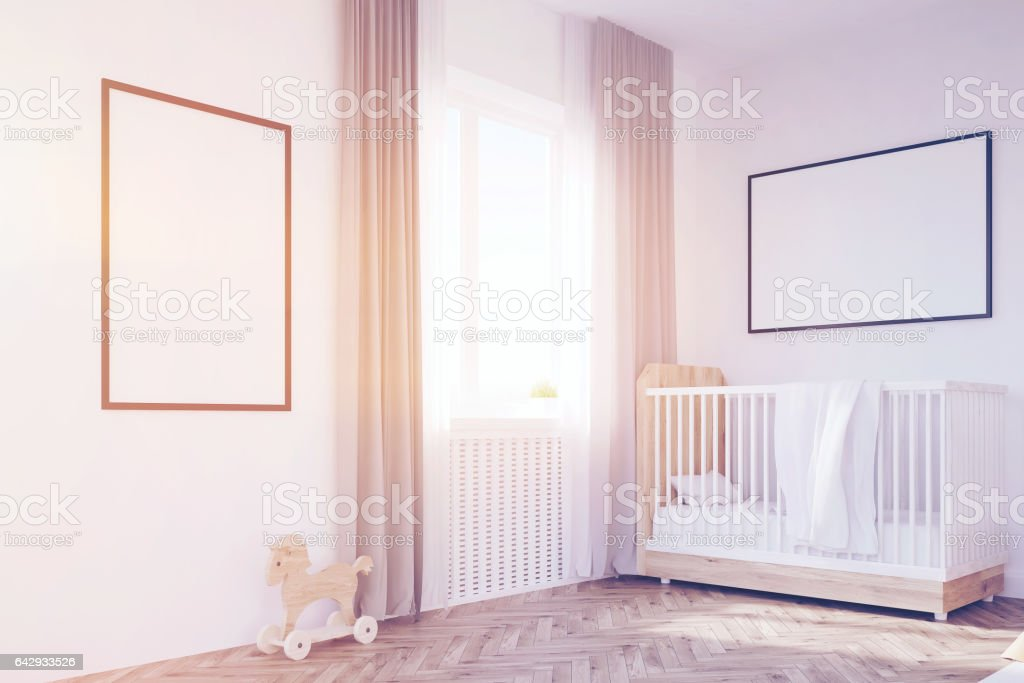 Corner of baby's room with a crib, toned stock photo