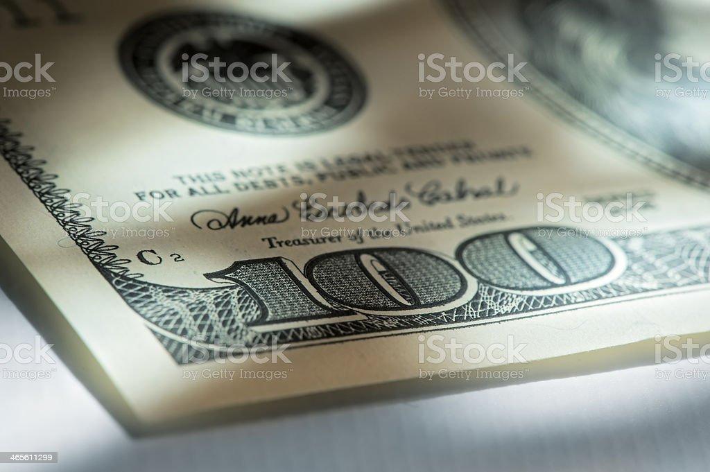 Corner of hundred dollar bills stock photo