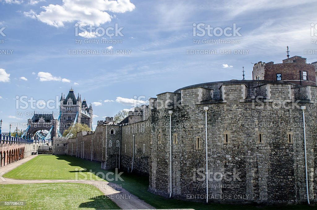 Corner of London Tower with Tower bridge behind stock photo