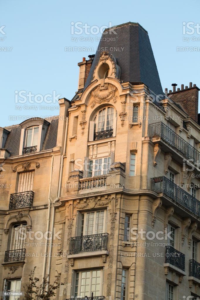 corner of of typical house with balcony in Paris, France stock photo
