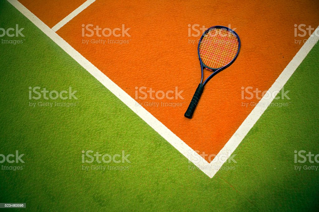 corner of playing field and tennis racket stock photo