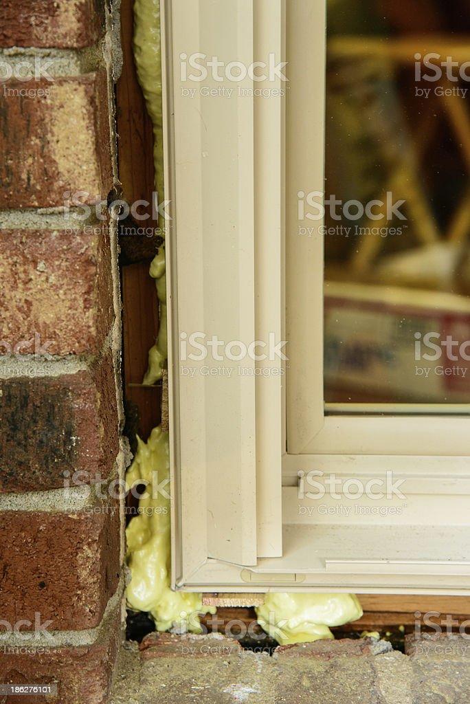 Corner of replacement window in brick opening stock photo
