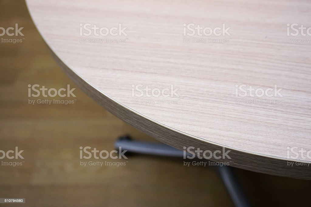 Corner of the wooden table in office stock photo