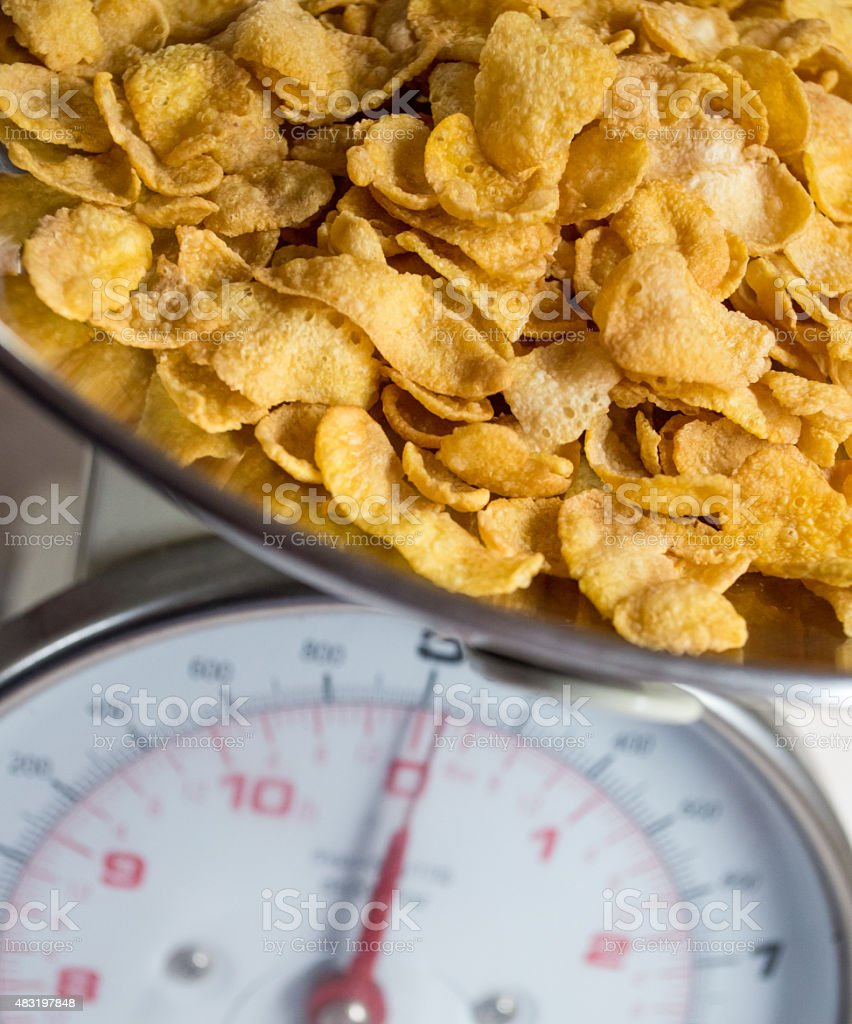 Cornflake Cereal on Weighing Scales royalty-free stock photo