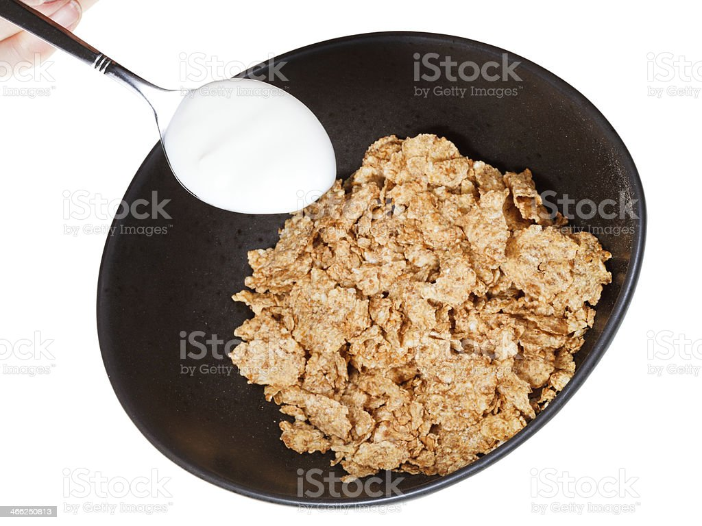 cornflakes and spoon with yogurt royalty-free stock photo