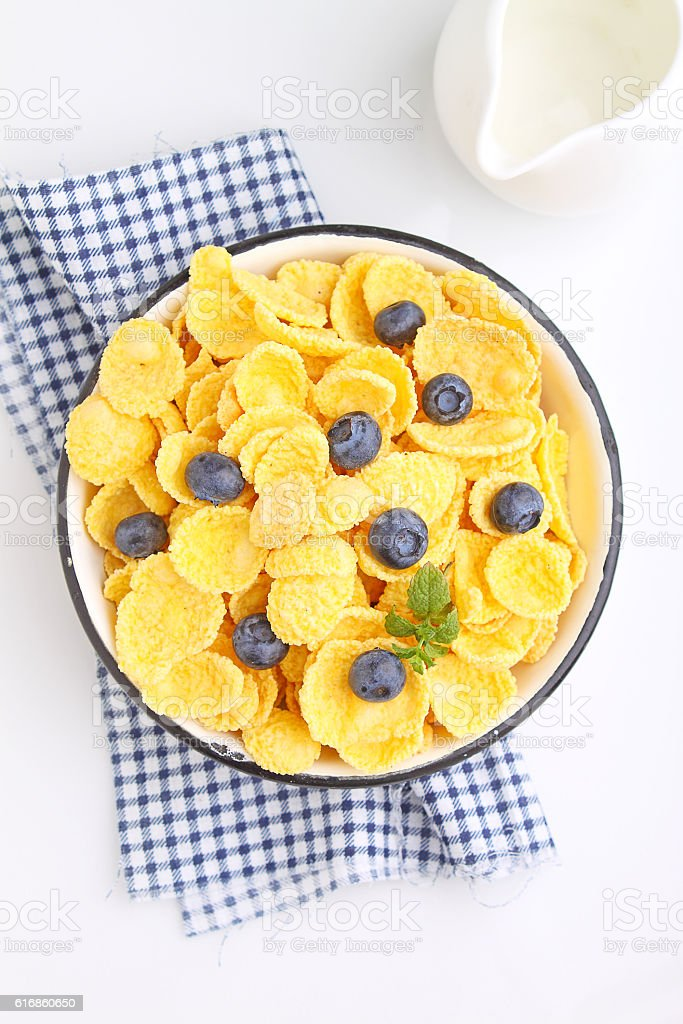 Cornflakes for breakfast with blueberries stock photo