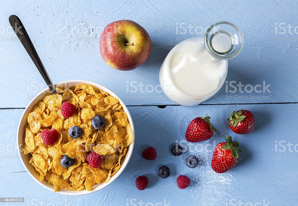 Cornflakes in a bowl with milk and fruits stock photo
