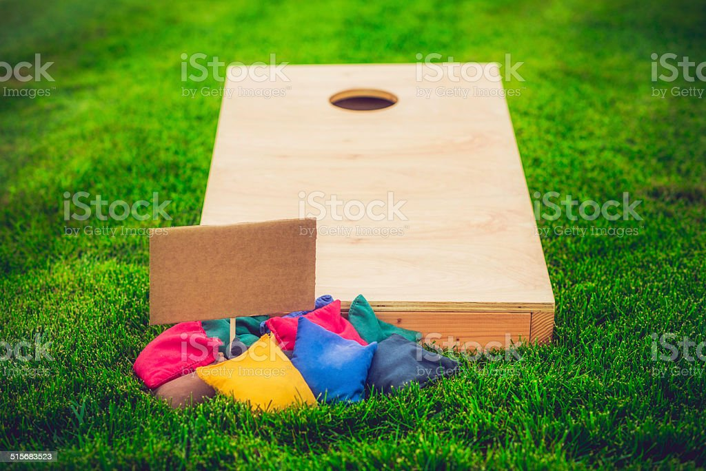 Cornhole Board and Bags with Sign for Message stock photo