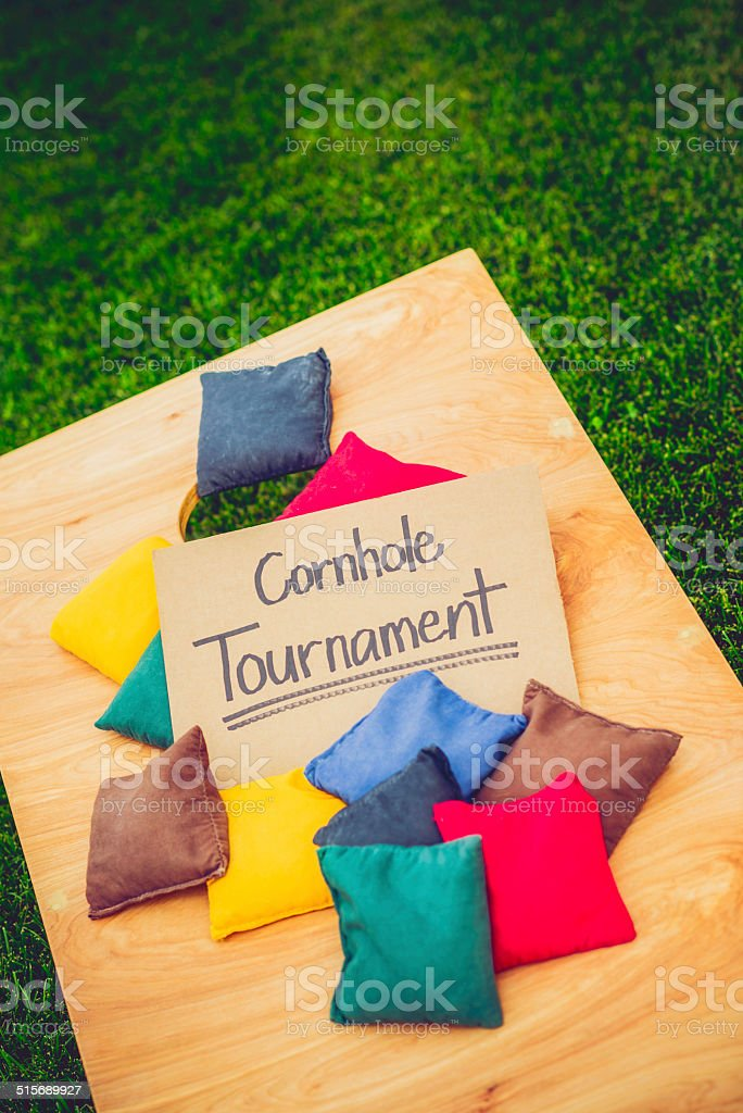 Cornhole Board and Bags with Tournament Sign stock photo