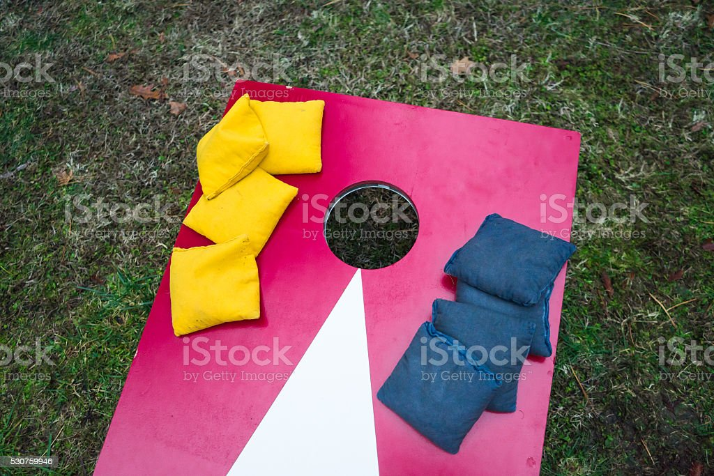 Cornhole Toss Game Board with Bags stock photo