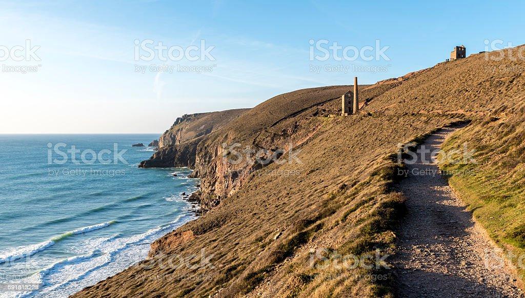 Cornish coastal path, with a derelict tin mine in view stock photo
