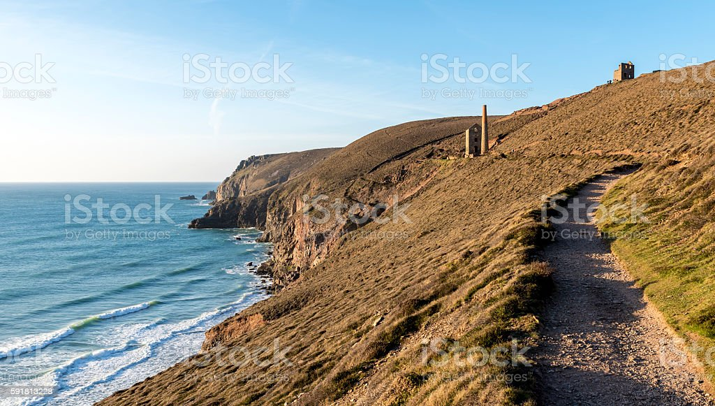 Cornish coastal path, with a derelict tin mine in view stock photo