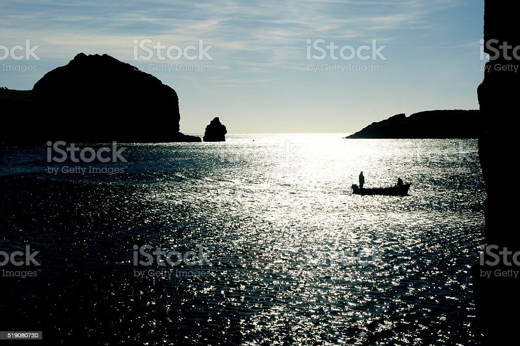 Cornish Fishermen return to harbour stock photo