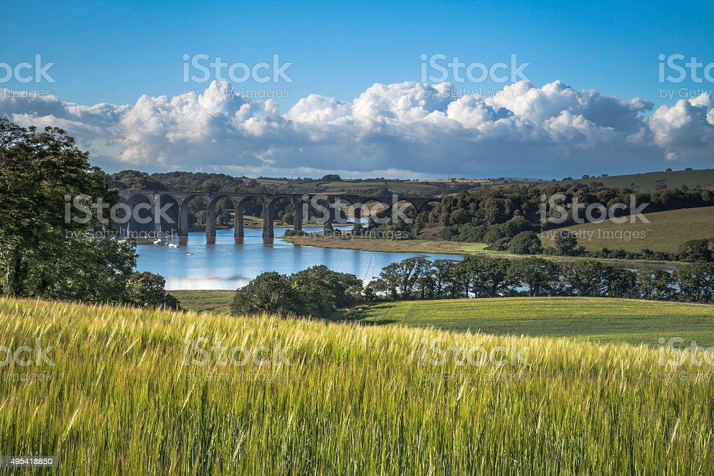 Cornish Landscape with railway viaduct and river boats, Cornwall. stock photo
