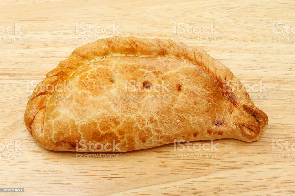 Cornish pasty on wood stock photo