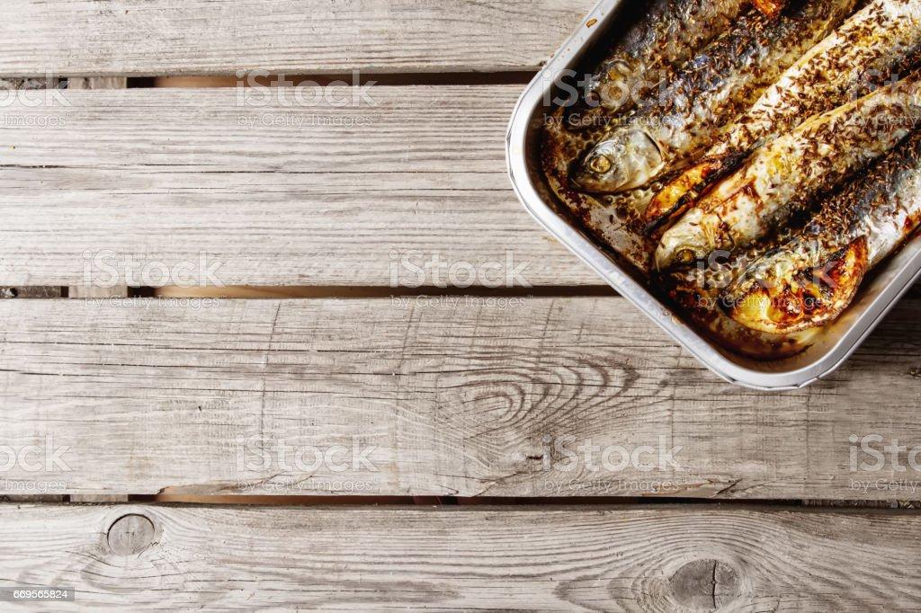 Cornish sardines. For grill and BBG. Dark background. stock photo