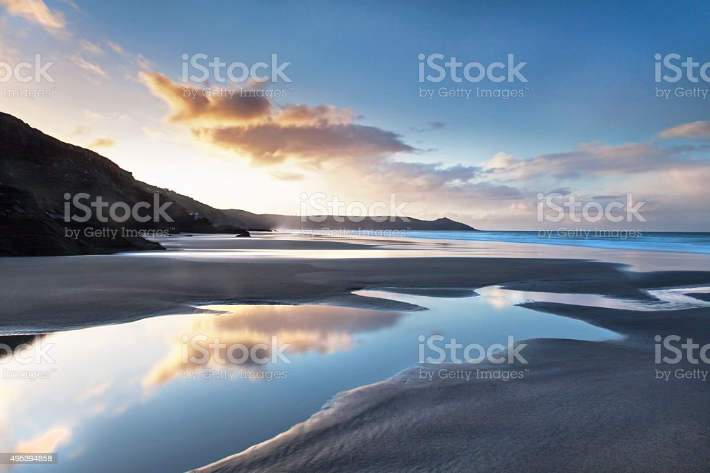 Cornish sunrise over sea and landscape, Cornwall, UK stock photo