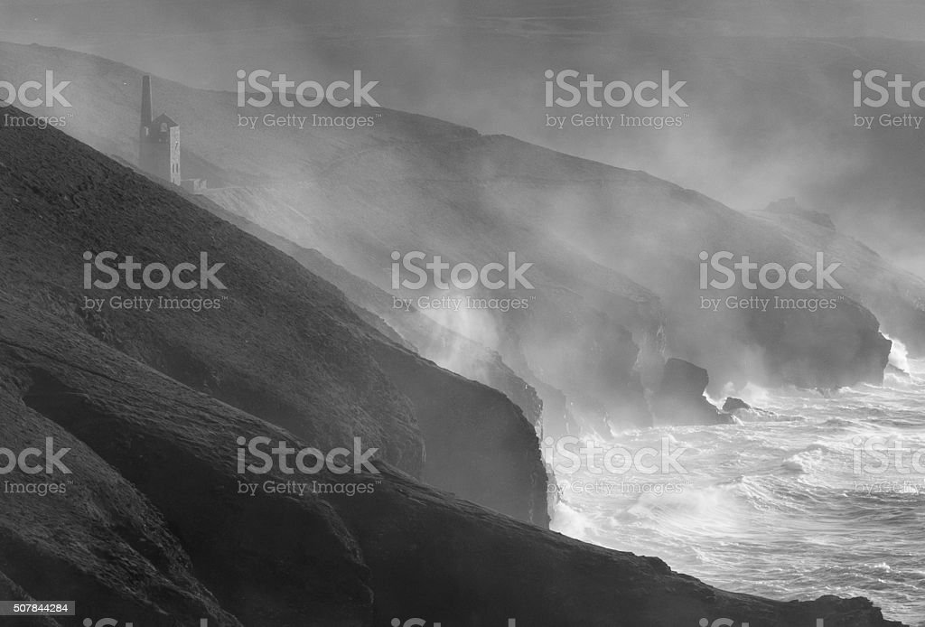 Cornish Tin mine on cliff north Cornwall in storm stock photo