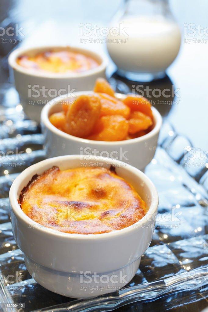 Cornmeal mush and dried apricots stock photo
