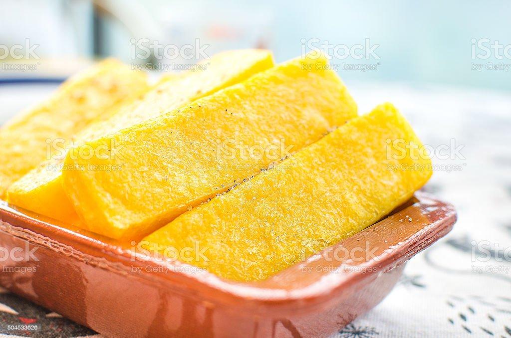 cornmeal mush slices closeup stock photo