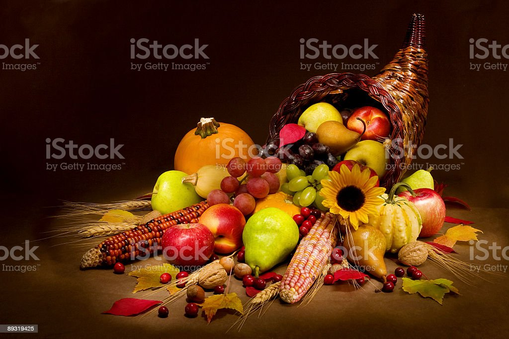 Cornucopia filled with multicolored fruits and vegetables stock photo