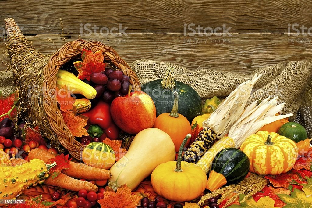 Cornucopia of autumn vegetables with wood background stock photo