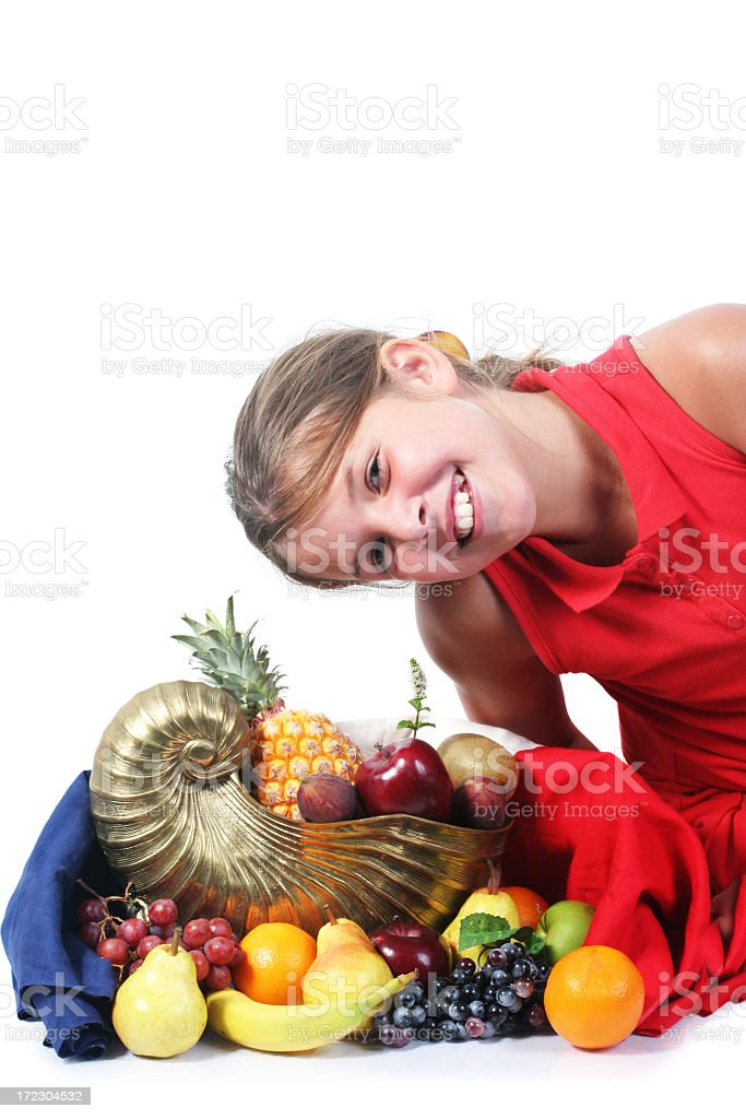 Cornucopia with fruits and girl royalty-free stock photo